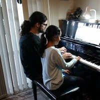 Degree qualified piano and vocal tutor with current working with children check