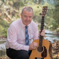 An experienced acoustic musician teaching folk, jazz, bluegrass, Irish guitar, theory, practical