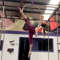 Pole Dance instructor in Adelaide, Australia teaching tricks, choreography, flexibility, and conditioning
